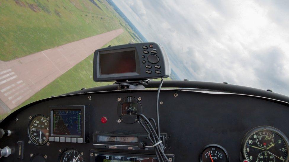 Light aircraft cockpit coming into land