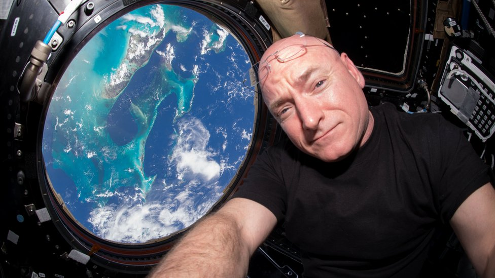 Handout photograph of Nasa astronaut Scott Kelly overlooking earth from space
