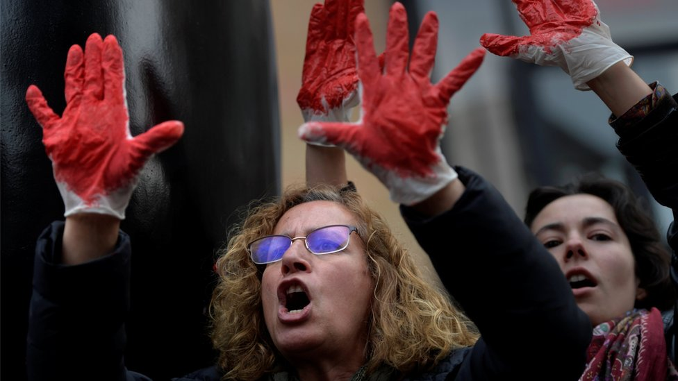 People shout slogans during a protest after a Spanish court condemned five men accused of the group rape of an 18-year-old woman, in Oviedo