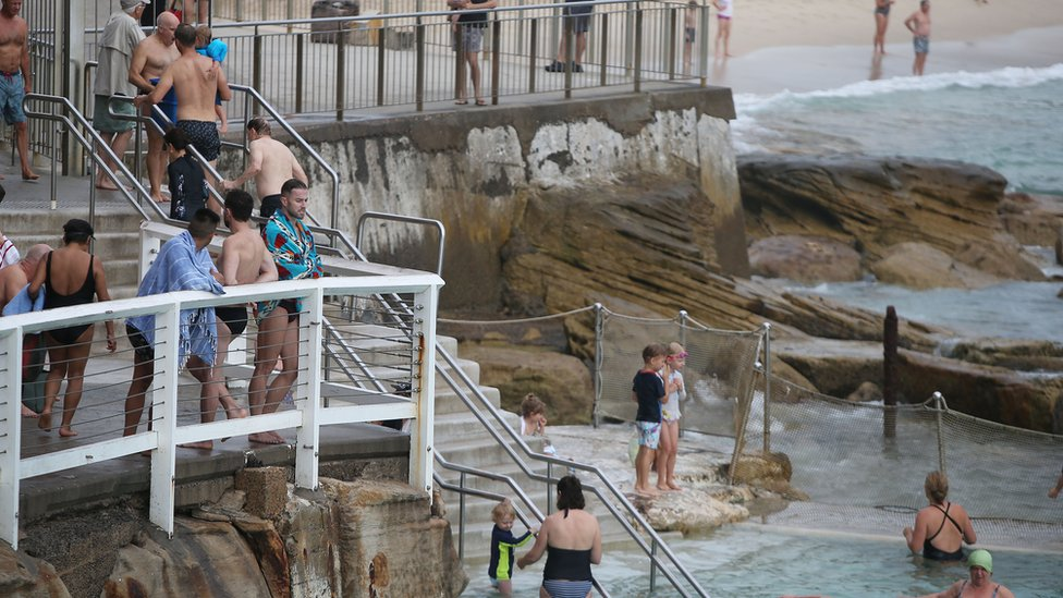 Swimmers and beachgoers at Bronte Beach in Sydney on Tuesday