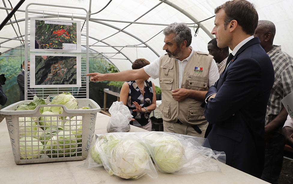 French President Emmanuel Macron attends a tour of a farm centred around ground pollution from the banned pesticide chlordecone on the French Caribbean island of Martinique, on September 27, 2018