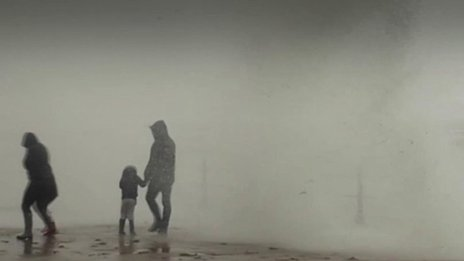 Family engulfed by huge wave on Penzance seafront