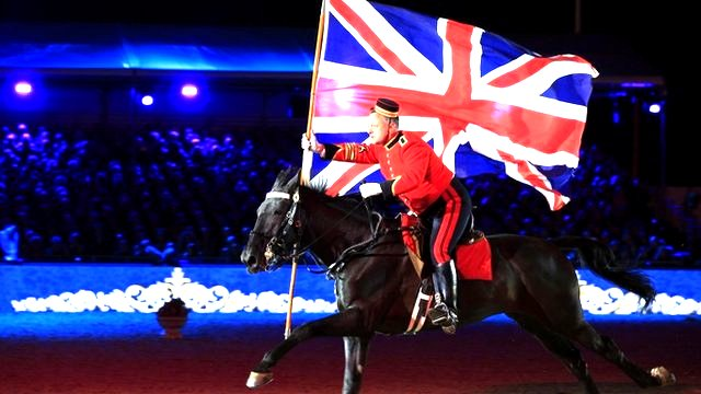 A Button Boy from the Household Cavalry rides through the arena during the Queen's 90th Birthday Celebration at the Royal Windsor Horse Show