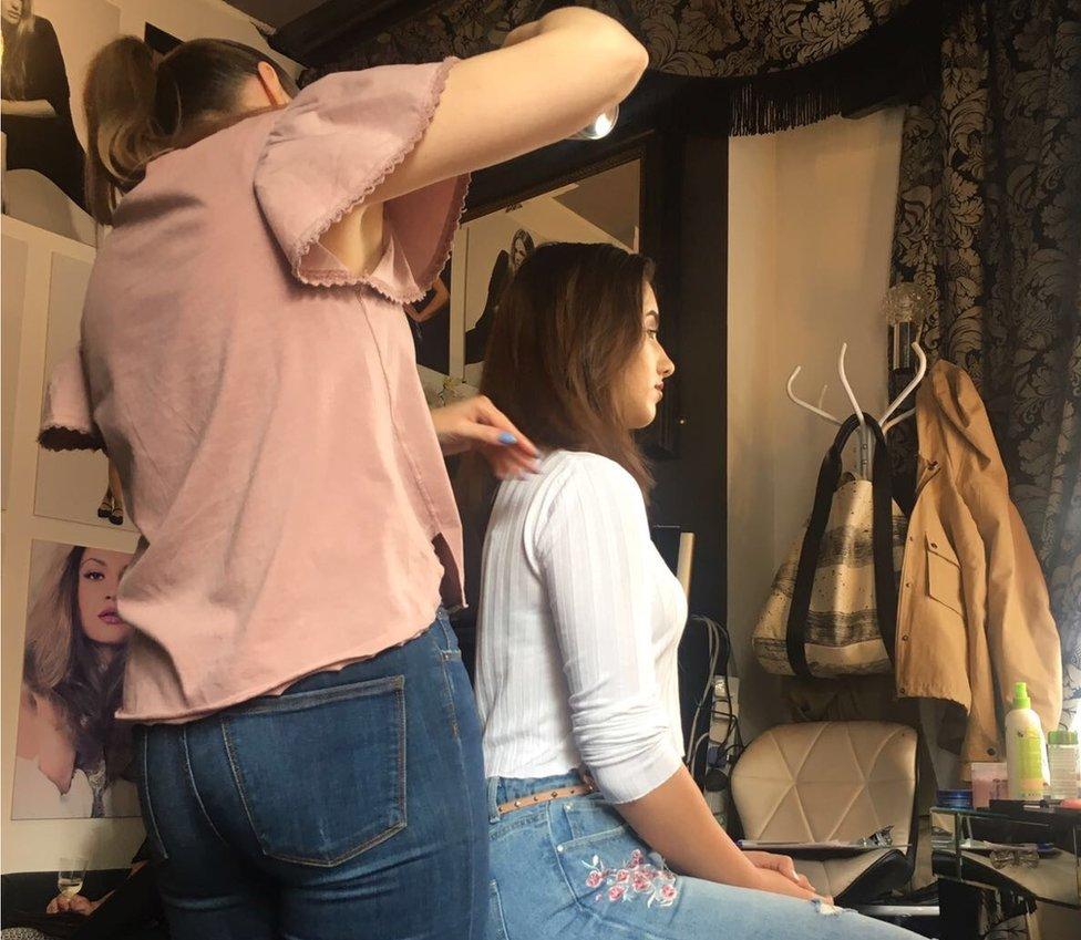 Dominika having her hair done
