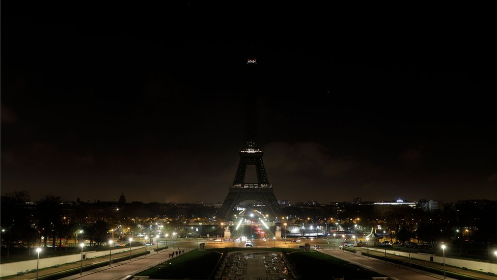 The Eiffel Tower goes dark in memory of the victims of the attack on Christmas shoppers at a market in Strasbourg, France, 13 December 2018