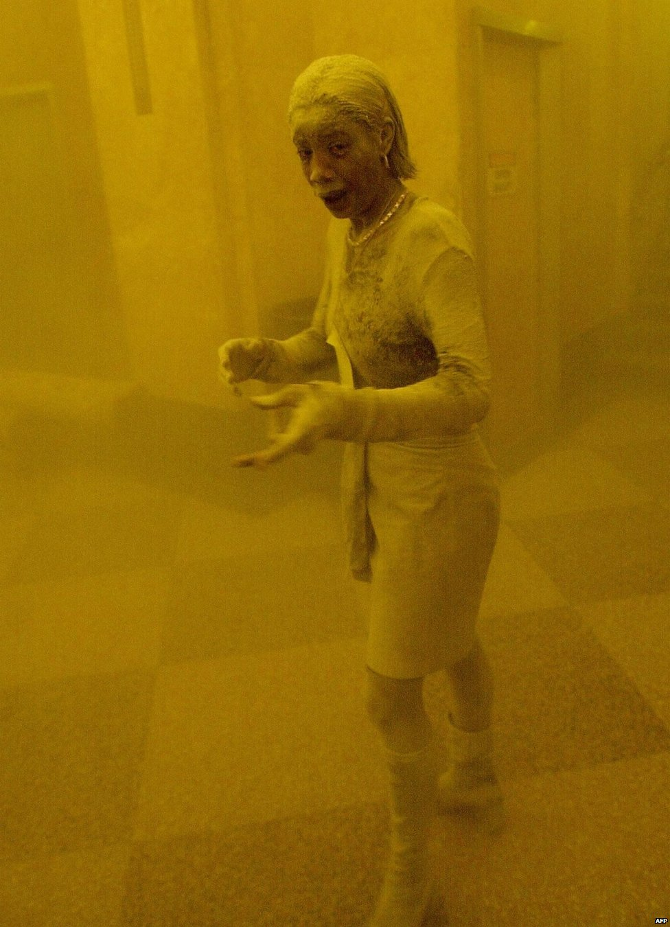 Marcy Borders covered in dust as she takes refuge in an office building after one of the World Trade Center towers collapsed in New York, September 11th 2001.