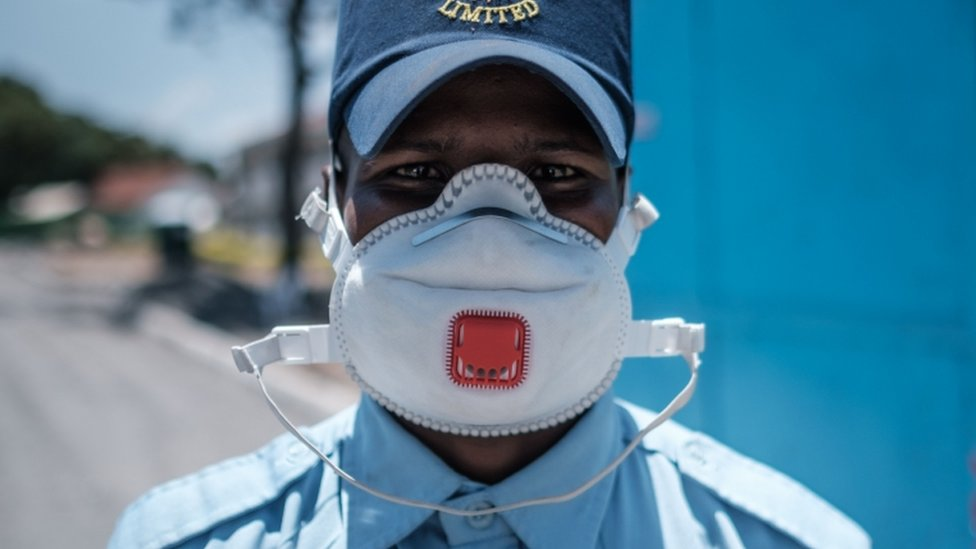 A security officer wearing a protective face mask poses for a picture at the entrance of the Infectious Disease Unit of Kenyatta National Hospital in Nairobi, Kenya, on March 15, 2020