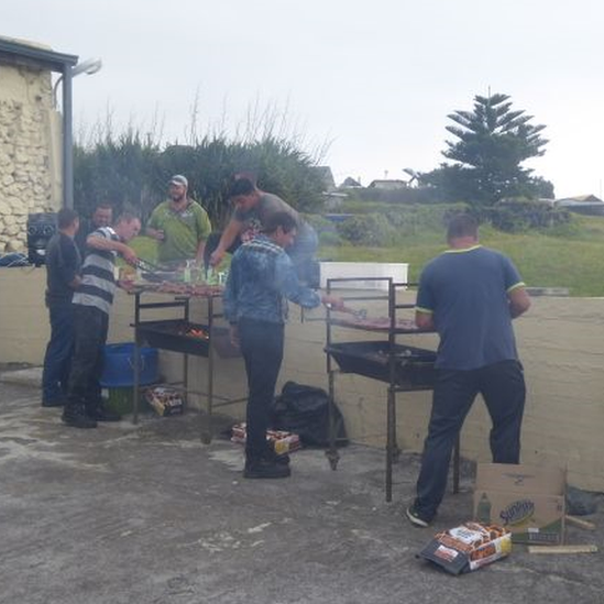 Island men making barbecues