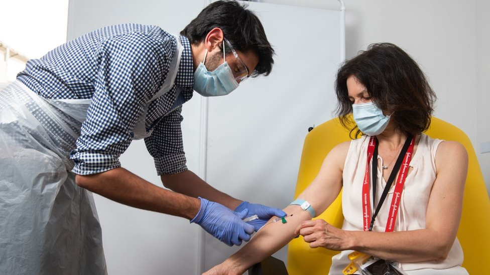 a volunteer being administered the coronavirus vaccine (vaccination) developed by AstraZeneca and Oxford University