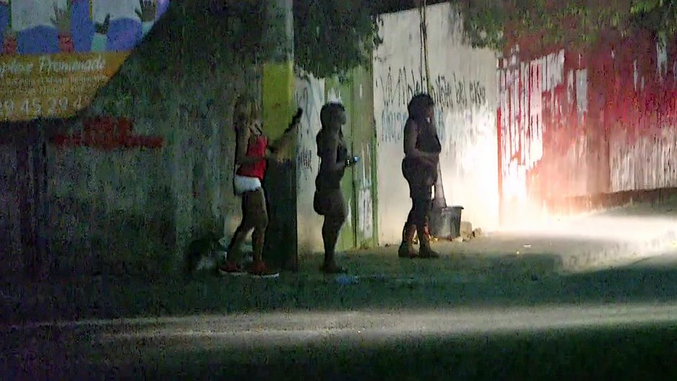 Women on a dark street in Haiti
