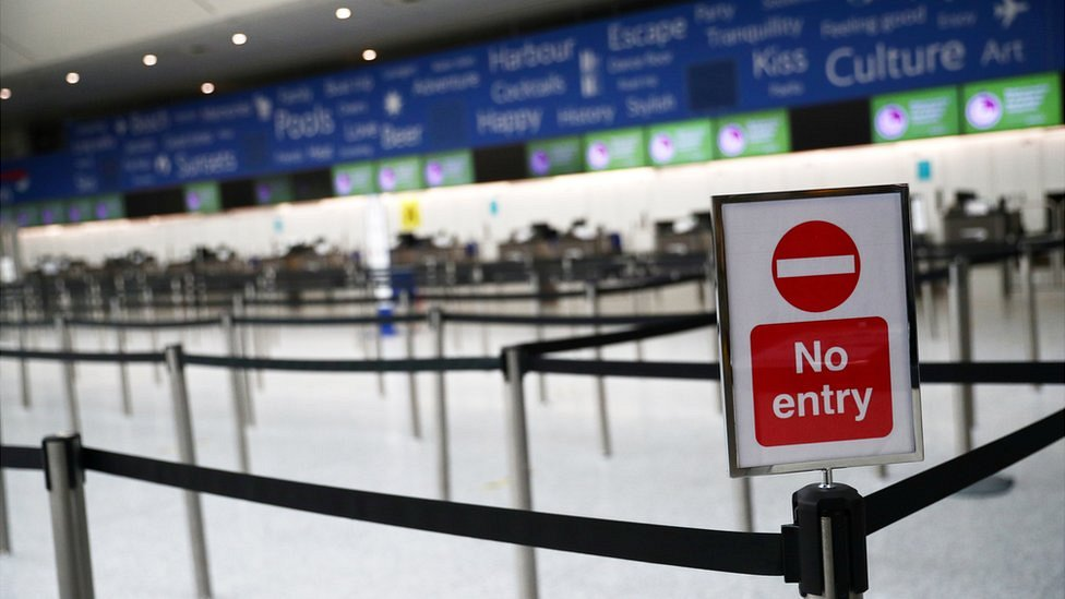 An empty British Airways check in desk area at an empty Gatwick airport