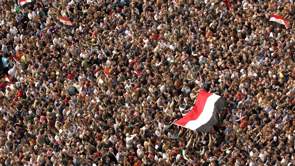 Egyptian anti-government protesters gather at Cairo's Tahrir Square on February 4, 2011