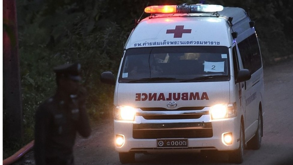 An ambulance exits from the Tham Luang cave area as rescue operations continue for those still trapped inside the cave in Khun Nam Nang Non Forest Park in the Mae Sai district of Chiang Rai province on July 9, 2018