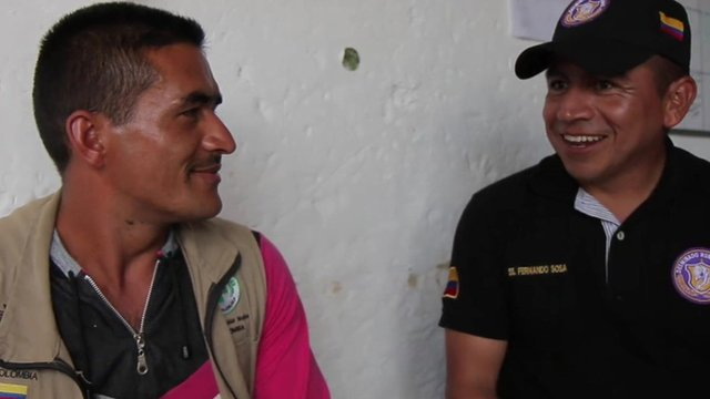 Farc rebel Hector Perez with a soldier of the Colombian Army