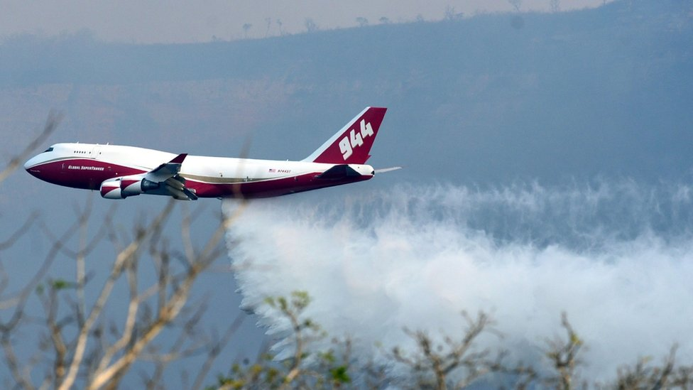 View of a Supertanker, an aerial firefighting airtanker, overflying the fires raging near Robore, Santa Cruz region, eastern Bolivia on August 23, 2019.