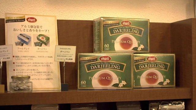 Boxes of tea on shelf