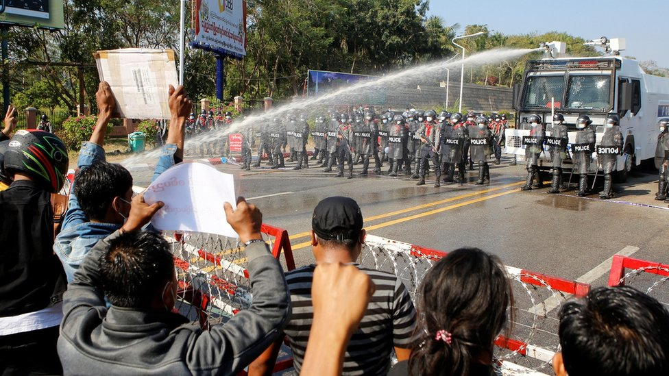 Police fire a water cannon at protesters rallying against the military coup and to demand the release of elected leader Aung San Suu Kyi, in Naypyitaw, Myanmar