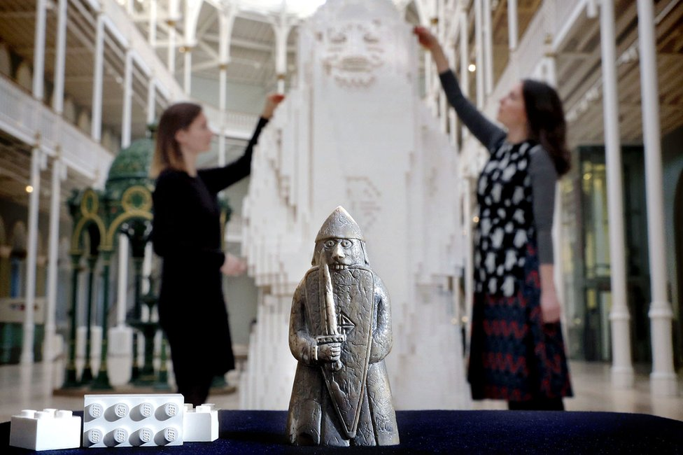 Lewis chessman and museum staff with Lego version