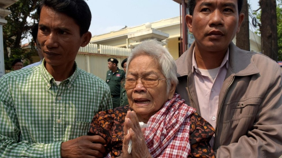 Sao Nget, led away by two men, while crying outside court on 1 Feb