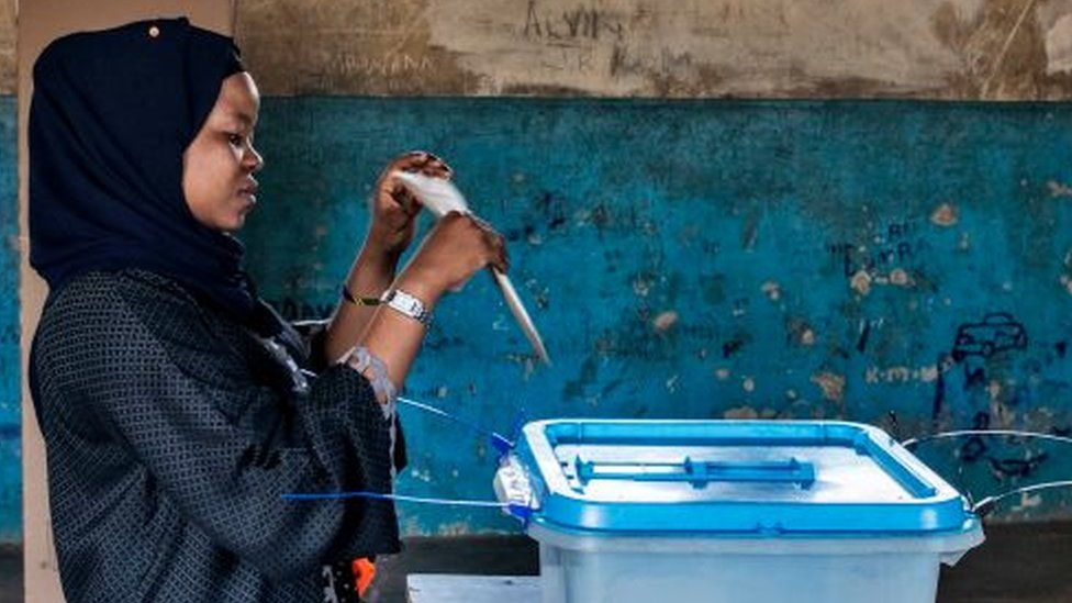 A voter casts a special vote ballot a day early, in line with to electoral dispensations, at a polling station in Zanzibar, on 27 October 2020.