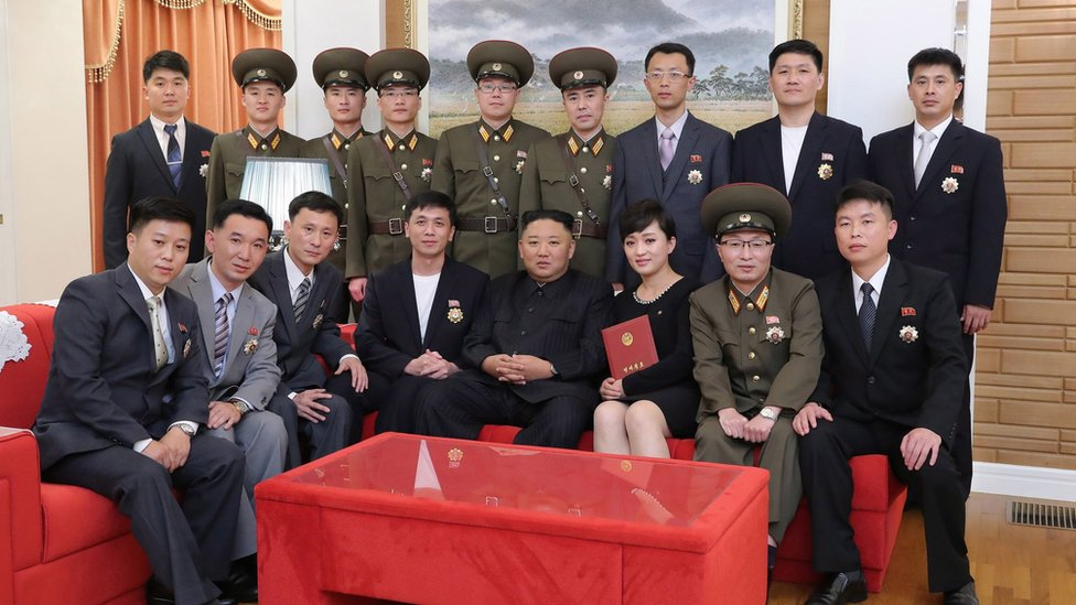 A photo released by the official North Korean Central News Agency (KCNA) on 12 July 2021 shows North Korean leader Kim Jong-Un (front C) meeting and congratulating creators and artistes of major art troupes who have received state commendations in Pyongyang, North Korea, 11 July 2021.