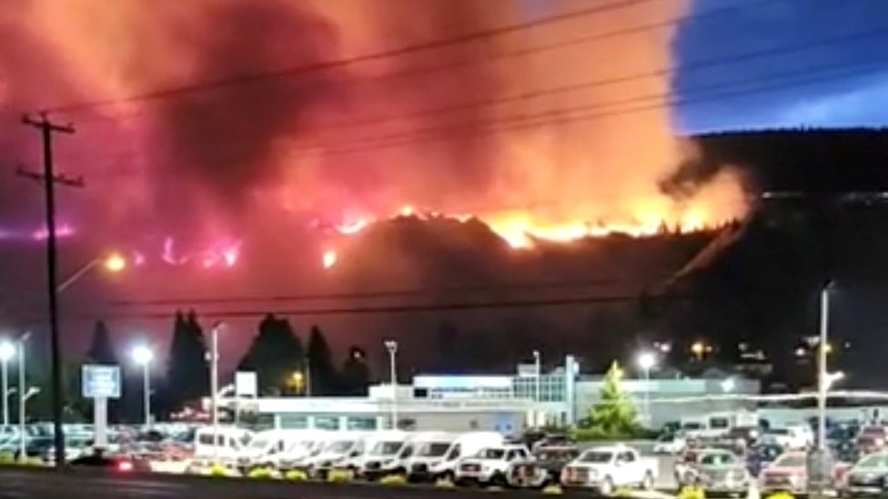 A wildfire burns on a hill in Kamloops, British Columbia, Canada, 1 July 2021