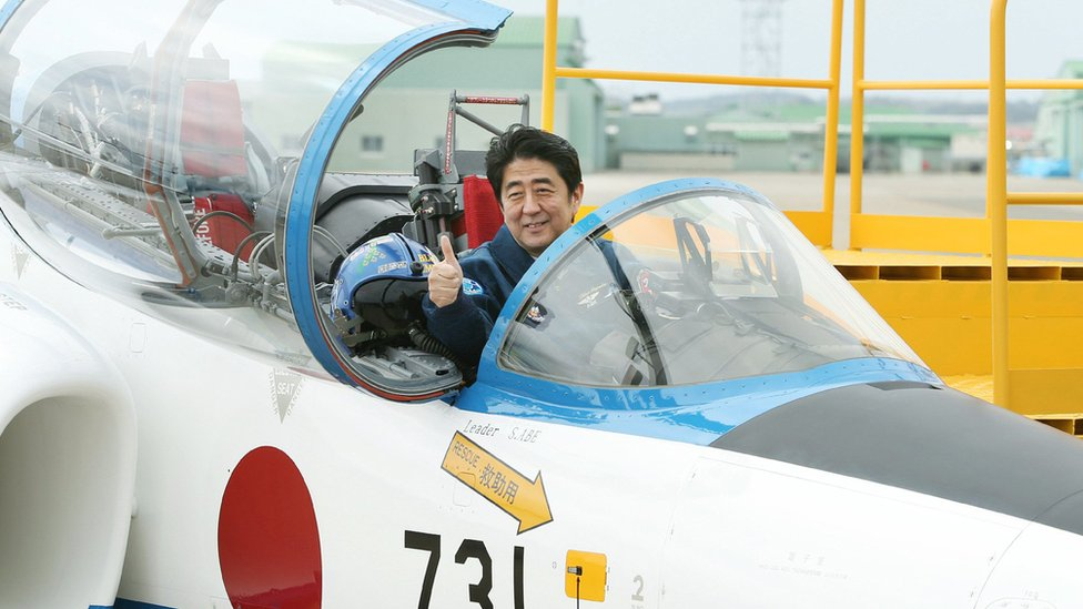 Shinzo Abe in a jet cockpit