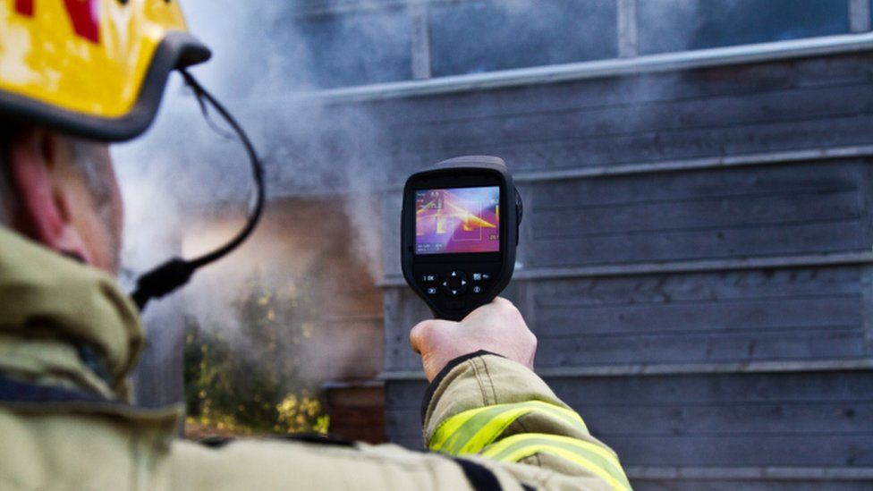 Firefighter using infrared camera