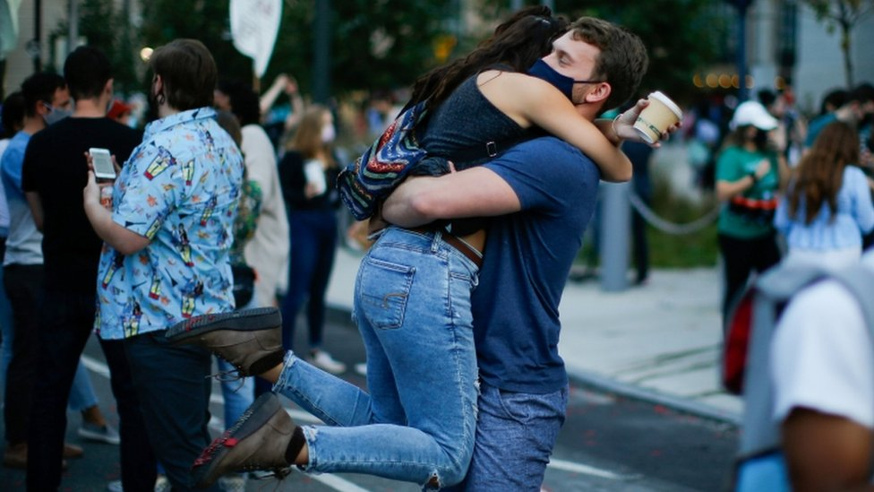 People hug as they celebrate in Philadelphia