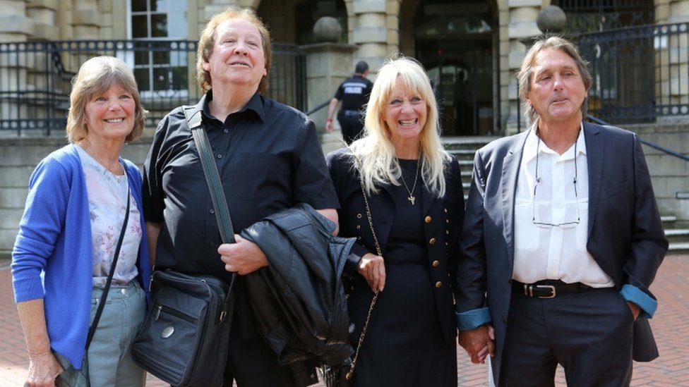 "Richard Westwood, 73 (second left) and Leonard ""Chip"" Hawkes, 70 (far right) with their wives Lynn (left) and Carol outside court"