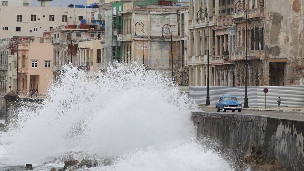 Waves splash at the seafront Malecon during the passage of the Tropical Storm Laura in Havana, Cuba