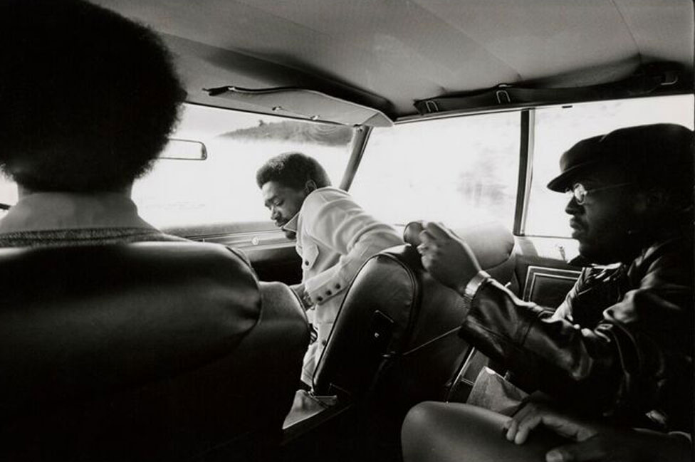 Bobby Seale, in front passenger seat, with other Black Panthers