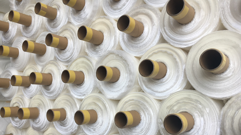 The fabric is exported in large rolls