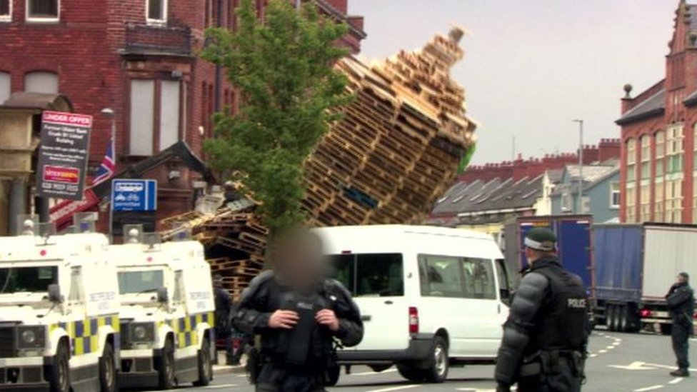 Police at scene of bonfire in Cluan Place
