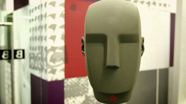 A model of a head which contains microphones