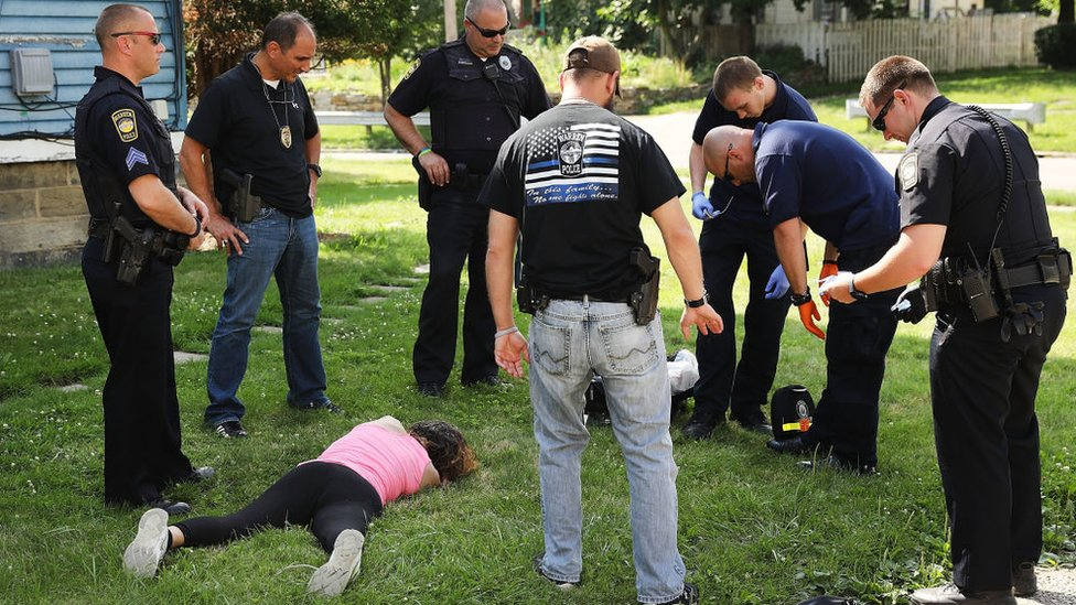 Woman who overdosed on heroin lying on the grass