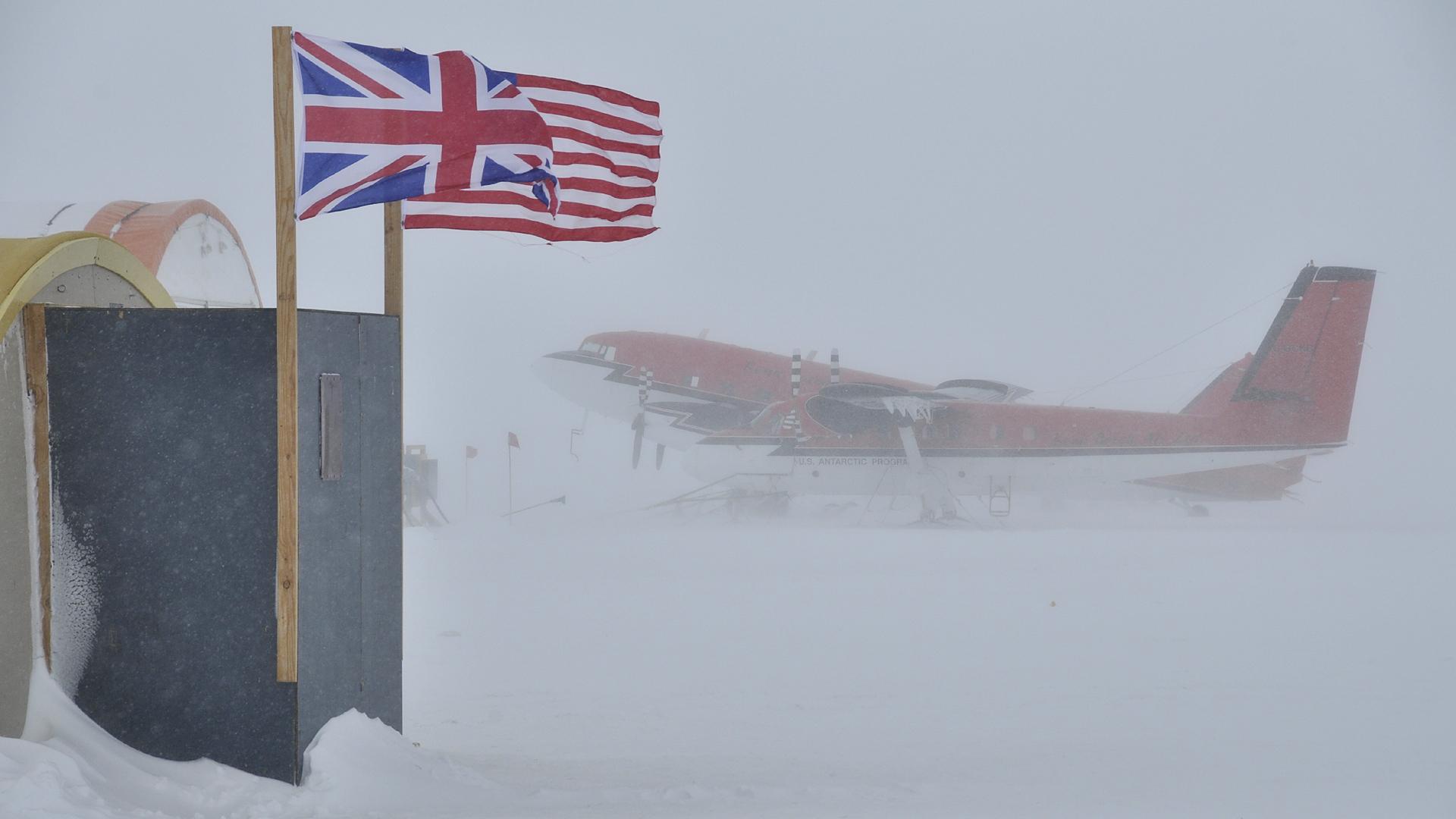 Plane seen through a blizzard on the ground