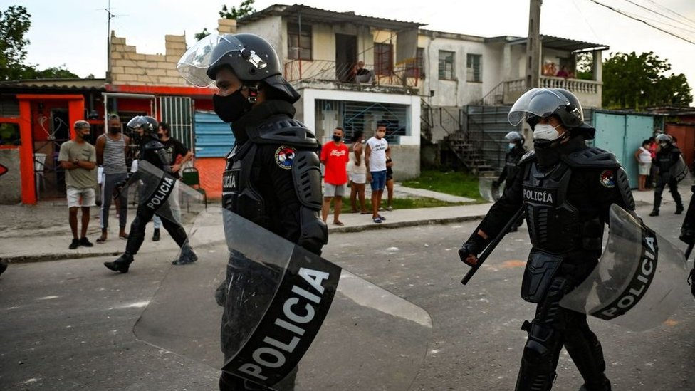 Police patrol a suburb of Havana after anti-government unrest, July 2021
