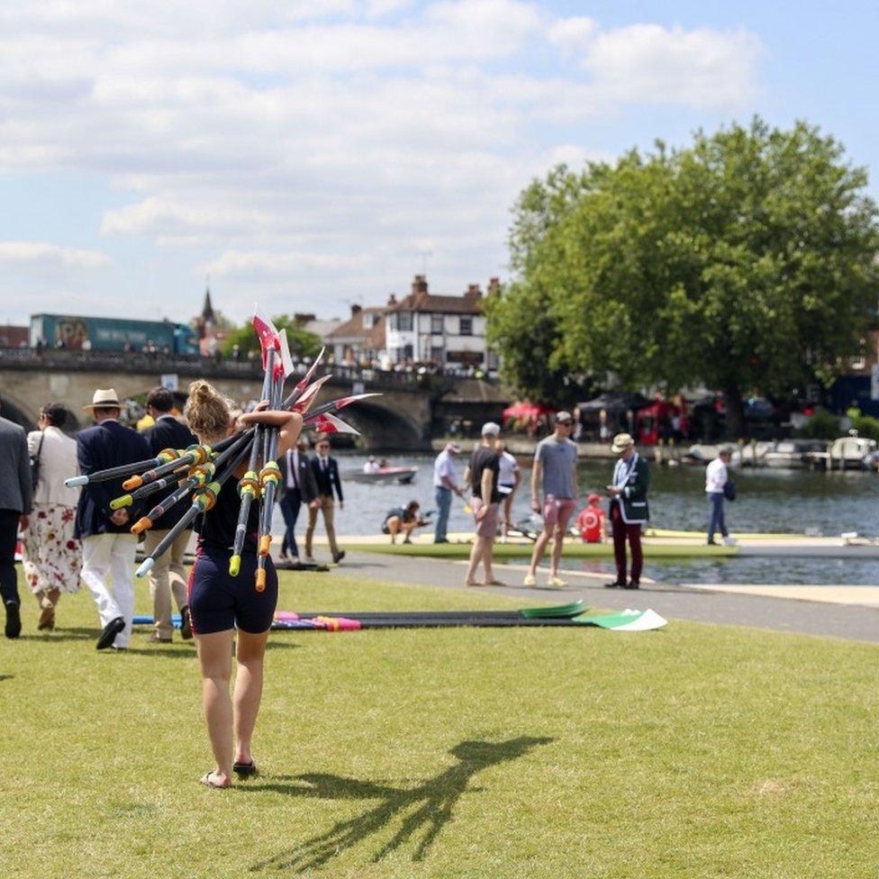Rower carrying oars