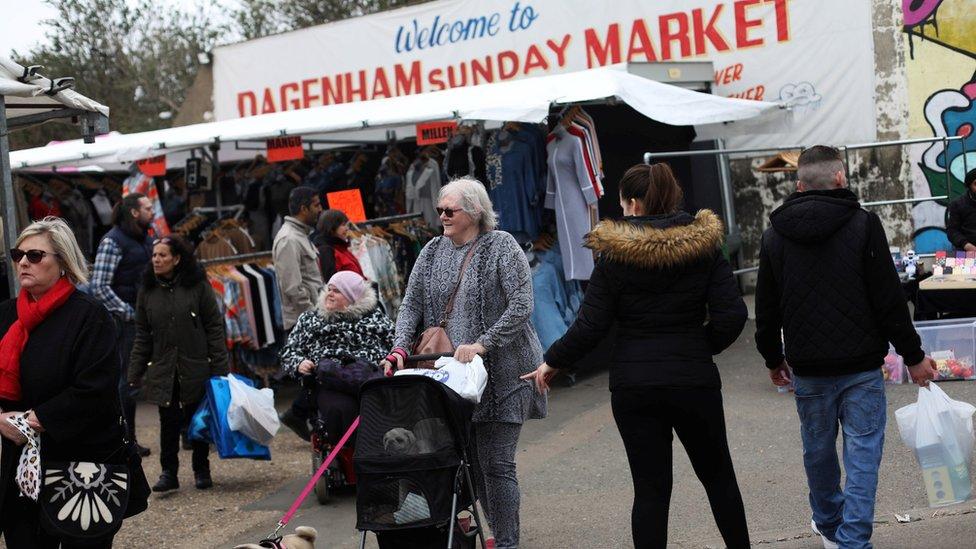People shop at Dagenham Sunday Market