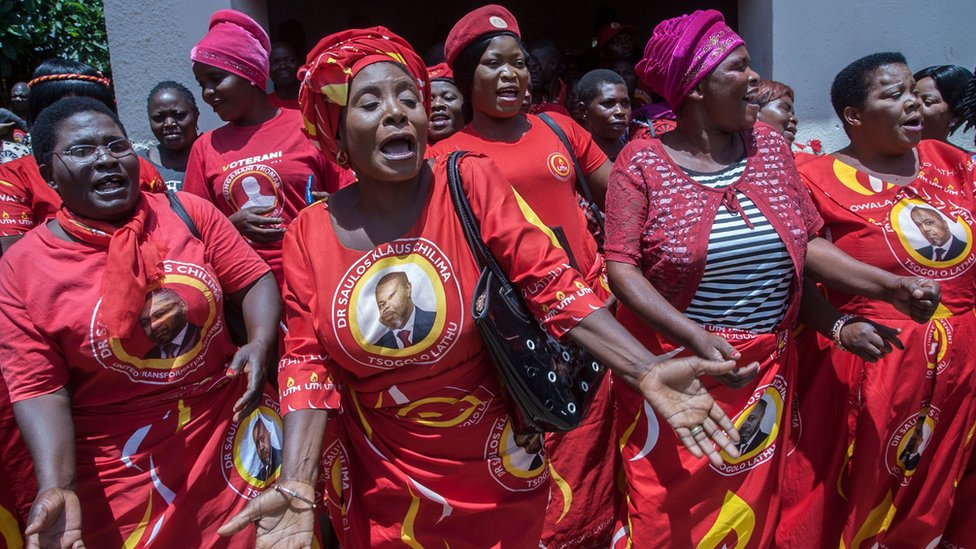 Supporters of Malawi's United Transformation Movement (UTM) dance in Lilongwe on 5 February 2020
