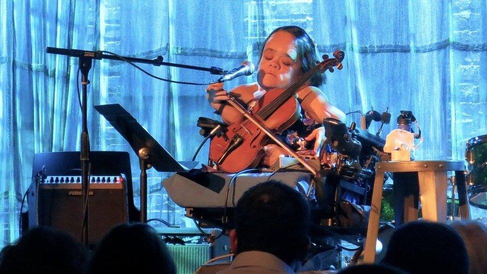 Gaelynn Lee performing on stage