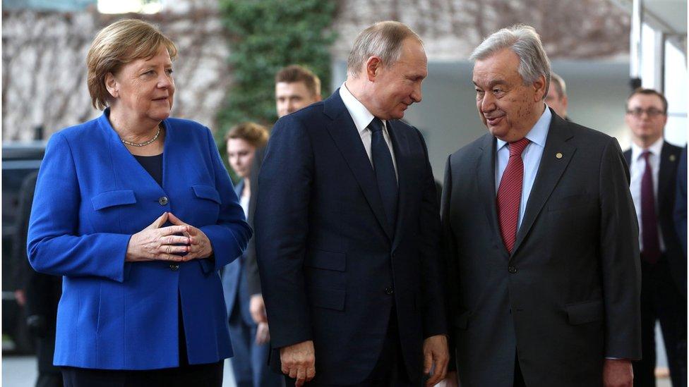 من اليسار: ميركل، بوتين، غوتيريش