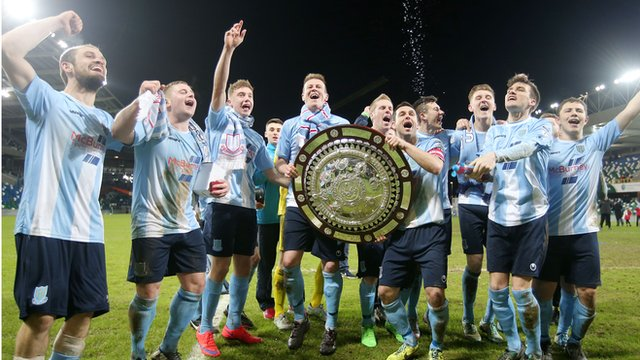 Ballymena United players celebrate winning the County Antrim Shield
