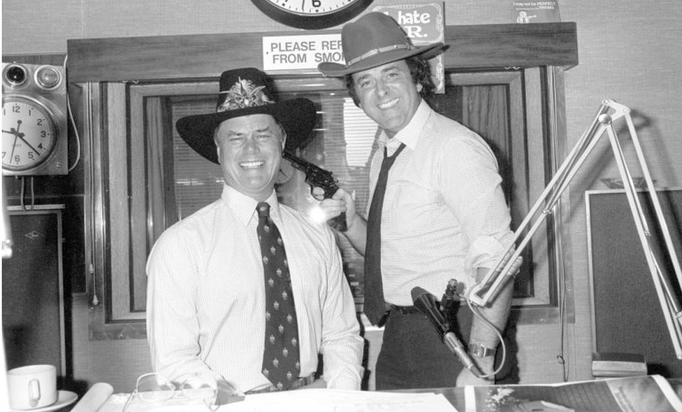 Larry Hagman (left) with Sir Terry Wogan during his Radio 2 Breakfast Show in September 1980