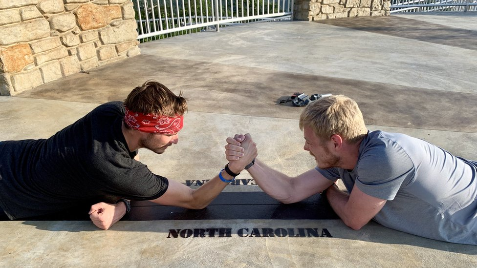 Patrick and Michael arm wrestling at Sassafras Mountain in South Carolina