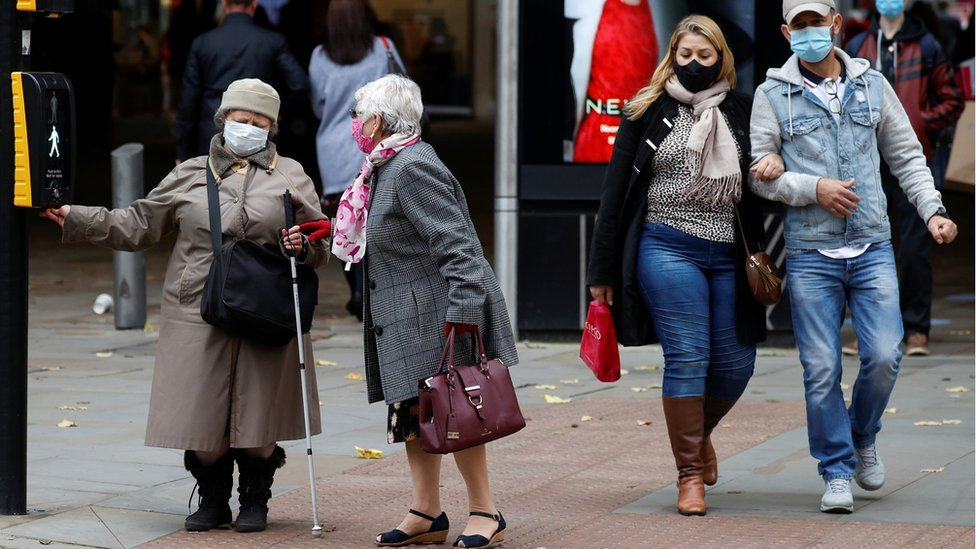 People wearing masks in Manchester