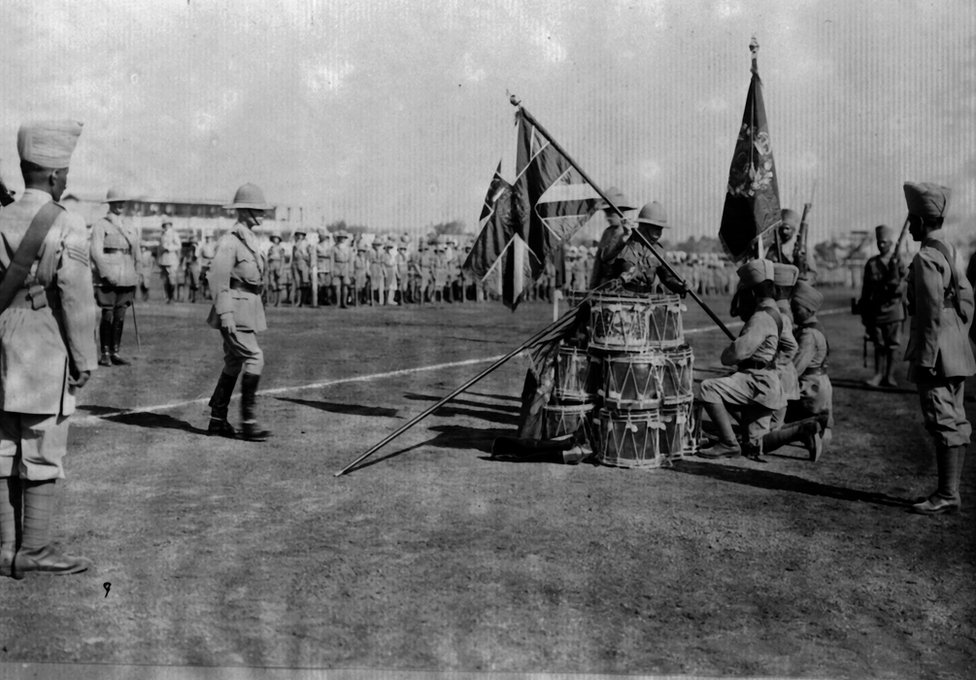 The Duke of Connaught (1850 - 1942) presenting colours at Poona to the 110th Madras.
