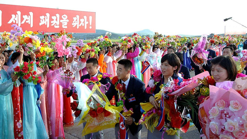 North Korea's 2012 Olympics squad returned home to a heroes' welcome, with cheering crowds lining the streets and the cabinet hosting a celebration banquet, according to the official news agency