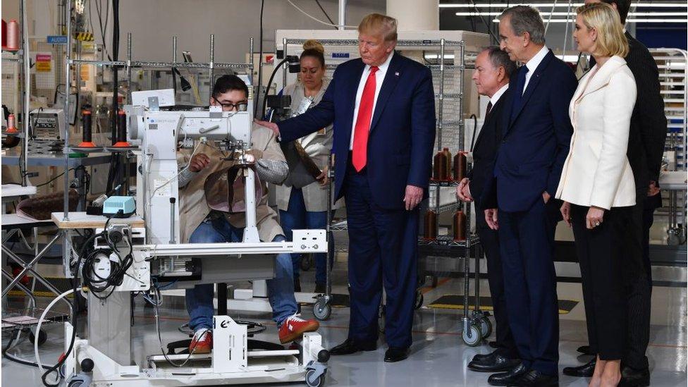 Donald Trump visits a US factory.